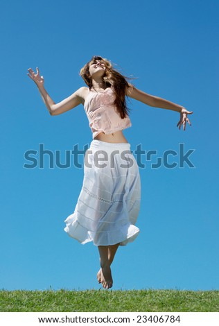 The happy young Girl on Outdoors - stock photo