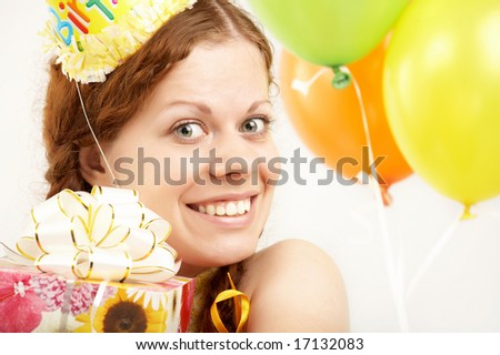 The happy young girl with gifts on a white background - stock photo