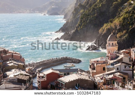 The harbor and bell tower of the village of Vernazza, one of the Cinque Terre towns in the Liguria region near La Spezia, Italy
