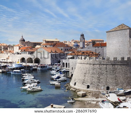 The Harbor and City Wall of Dubrovnik, Croatia - stock photo