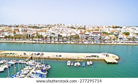 The harbor and the village Lagos in the Algarve Portugal - stock photo