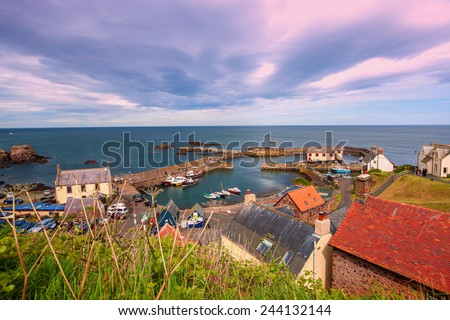 the harbour and village at St. Abbs in Berwickshire, Scotland - stock photo