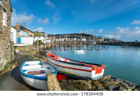 The harbour at Mousehole in Cornwall, a traditional fishing village near Penzance. - stock photo