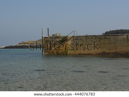 The Harbour of Old Grimsby with the Ruin of The Old Blockhouse in the Background on the Island of Tresco in the Isles of Scilly, England, UK