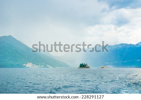 The hard rain over the islets of St George and Our Lady of the Rocks, Perast, Montenegro.