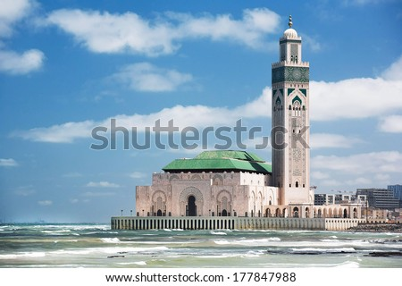 The Hassan II Mosque, located in Casablanca is the largest mosque in Morocco and the third largest mosque in the world after the Grand Mosque of Mecca and the Prophet's Mosque in Medina - stock photo