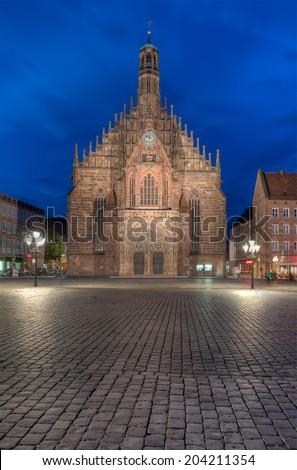 The Hauptmarkt in Nuremberg with the Frauenkirche. - stock photo