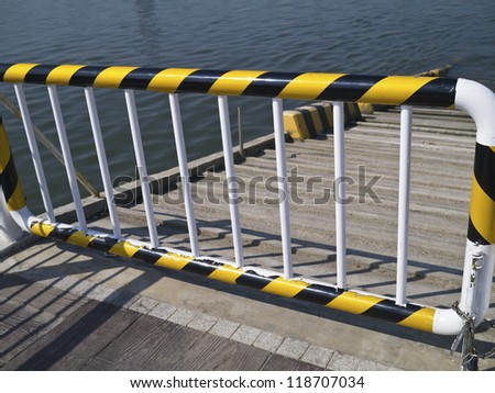 The hazard warning on the lock gate at wharf - stock photo
