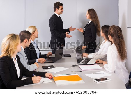 The head of office warmly greeting new american business partner - stock photo