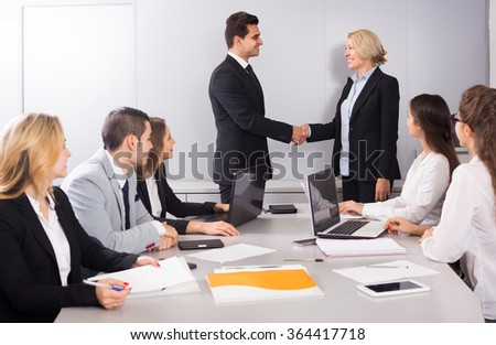The head of office warmly greeting new spanish business partner - stock photo