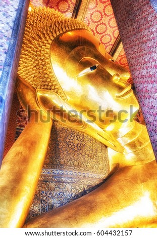 The Head of the Reclining Buddha in Wat Pho, Bangkok, Thailand