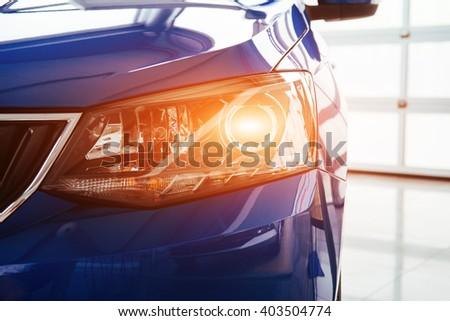 The headlights and hood Blue sports car - stock photo