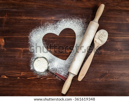 The heart of flour on the table from old boards.