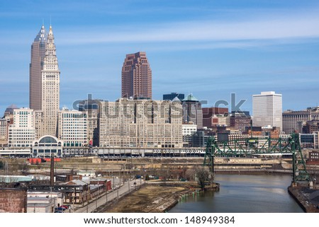 The heart of the downtown Cleveland, Ohio business district as viewed from the Hope Memorial Bridge on the near west side of town including the major tall buildings and the Cuyahoga River - stock photo