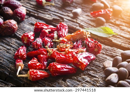 the heart of the dry red pepper closeup on wooden background selective focus - stock photo