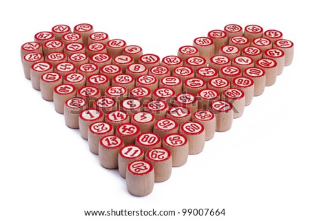 The heart of wooden kegs for bingo isolated on white background - stock photo