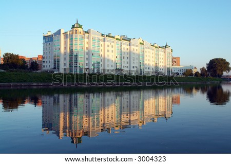 The high-rise building on bank on a sunset - stock photo