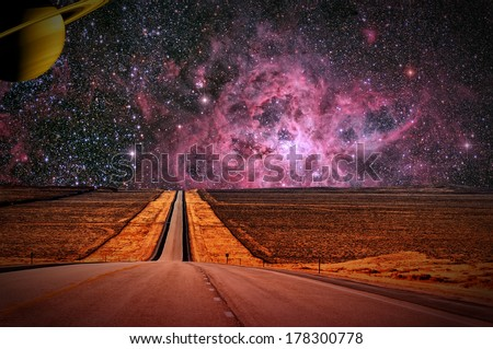 The high road on a distant moon. Images of Small Magellanic Cloud and Saturn courtesy of NASA. - stock photo