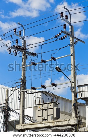 The High voltage electrical transformer is installed on the platform of a high concrete pole, and high power of electric voltage cable,  the danger area. vertical image - stock photo