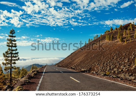 the highway above the clouds in the desert on the volcano - stock photo