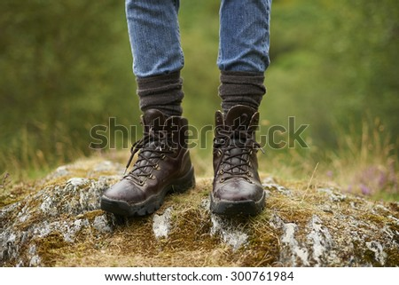 The hiking boots of a woman in the countryside