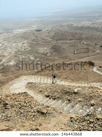 The hiking trail in ancient fortress Masada - Dead Sea, Israel - stock photo