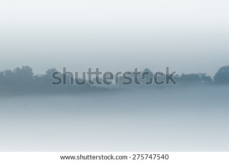 the hill in the mist - stock photo