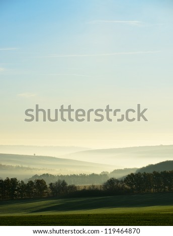 The hills in the fog. Morning landscape