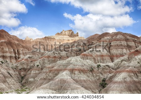The hills in the South Dakota Badland are created from erosion through layers of soft rock and mud. The hills look much larger than they really are. - stock photo