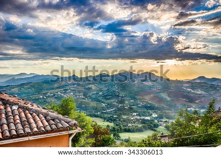 the hills of Romagna in Italy seen from a medieval village