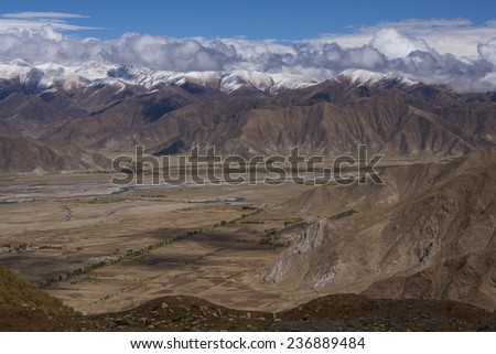 The Himalaya Mountains high on the Tibetan Plateau in Tibet, Tibet Autonomous Region of China. - stock photo