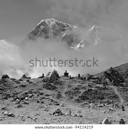 The himalayan mountain in the clouds (black and white) - Nepal, Himalayas - stock photo