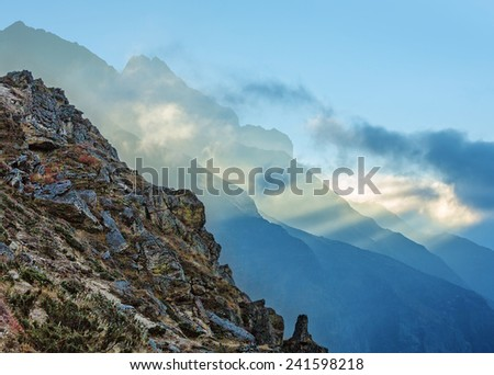 The himalayan peaks in mist from Thame village - Nepal, Himalayas - stock photo