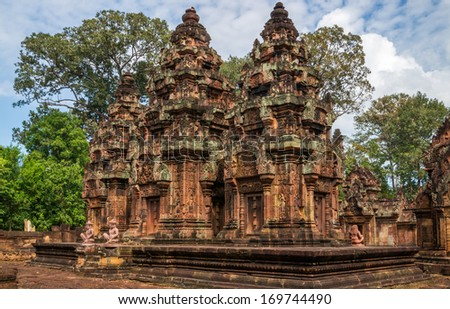 The hinduistic Banteay Srey Temple at the Angkor Wat area dates back to the 10th century and is dedicated to Shiva - stock photo