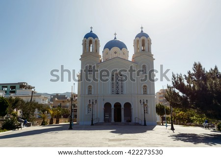 The historic church of St. Nikolaos in Karystos, Evia, Greece against a blue sky in the afternoon - stock photo