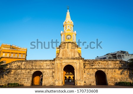 The historic clock tower gate is the main entrance into the old city of Cartagena, Colombia - stock photo