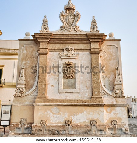The historic hellenistic fountain, built in 16th century, in Gallipoli's old town, in Salento. Apulia. Italy.