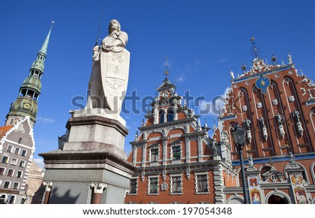 The historic House of the Blackheads, St. Peter's Church and statue of Saint Roland in the old town of Riga in Latvia. - stock photo