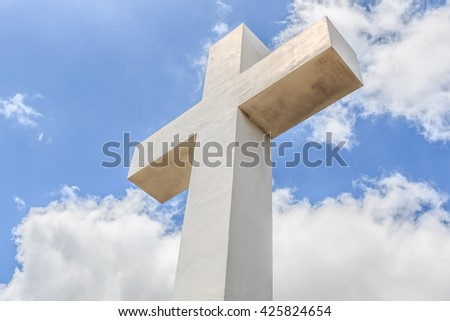 The historic Mt. Helix cross with a cloudy blue sky in La Mesa, a city in San Diego, California.   - stock photo