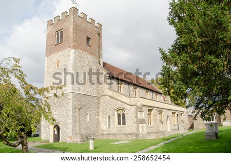 The historic parish church of St John the Baptist in the Hampshire market town of Alresford.   - stock photo