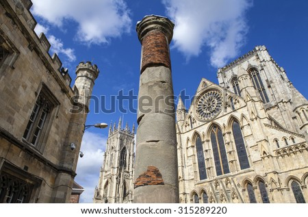 The historic Roman Column with York Minster in the background in York, England. - stock photo