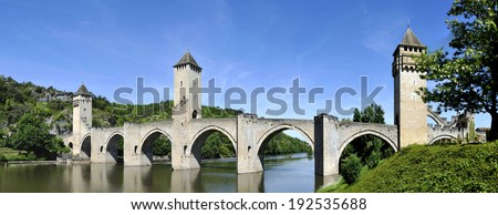 The historic XIV century Pont Valentre fortified bridge crossing the Lot River , in France. It has become a symbol of the city.It was built between 1308 and 1378  - stock photo