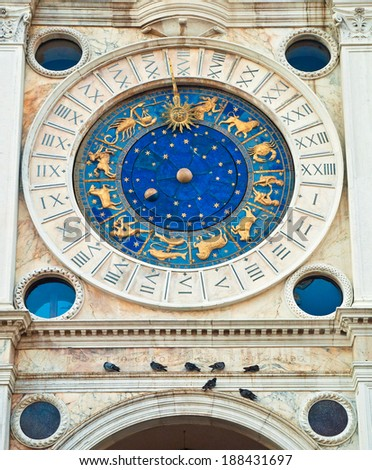 The historical clock on the Torre del' Orologio on the St. Mark's square in Venice