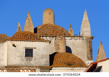 The historical hilltop fortified town of Monsaraz, Evora. Architectural detail viewed from the battlements of the ruined medieval castle. Alentejo Region, Portugal. - stock photo