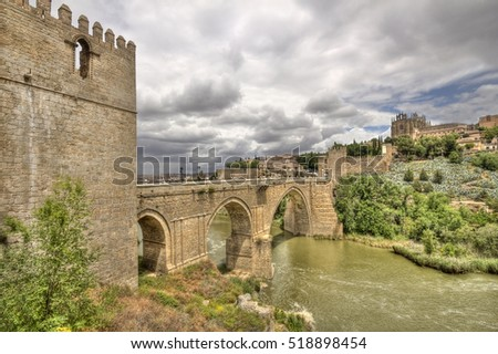 The historical Puente de San Mart�­n, or Saint Martin's brdge, across the river Tagus in Toledo, Spain