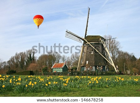 The historical windmill in the Dutch countryside - stock photo