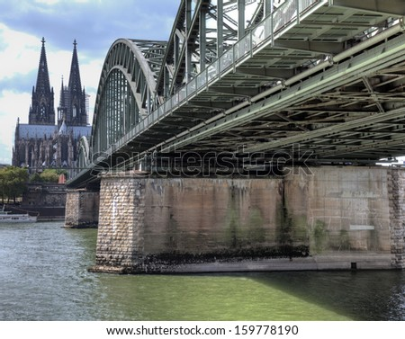 The Hohenzollern Bridge and Cathedral in Cologne, Germany.