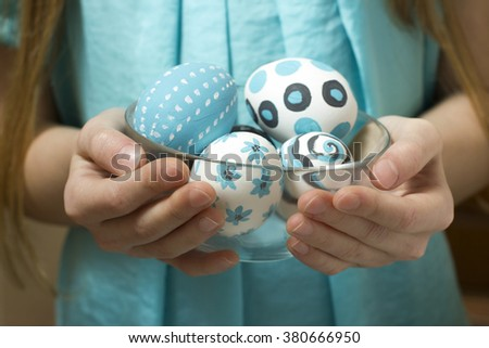 The holiday of Easter is decorated by painted eggs, a life symbol. Children and adults like to decorate eggs in different colors and patterns. - stock photo