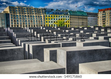 The Holocaost monument in Berlin, Germany (consist of 2711 concrete blocks whit different highs and parallel alignment placed on 19.000 squaremeters urban area) - stock photo