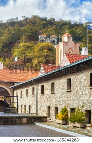 The Holy Monastery of the Virgin of Kykkos yard and belltower in Troodos mountains, Cyprus. - stock photo